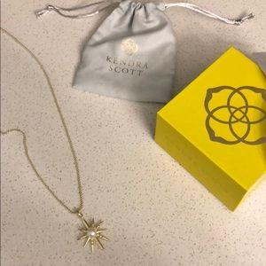 Gold Kendra Scott necklace.
